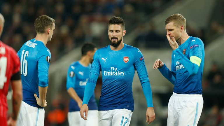 Rob Holding, Olivier Giroud and Per Mertesacker react after going behind against Cologne