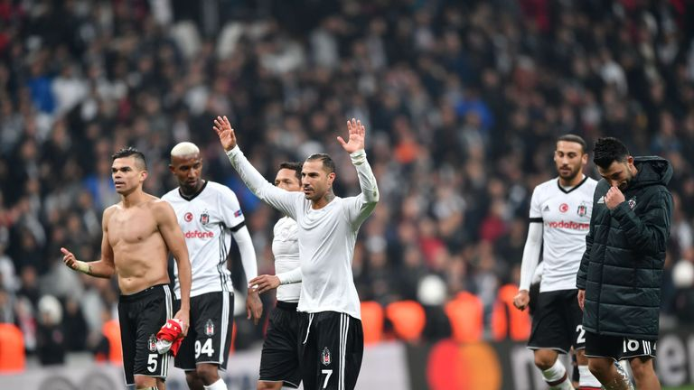 Besiktas' players celebrate with their fans after maintaining their unbeaten start to the Champions League