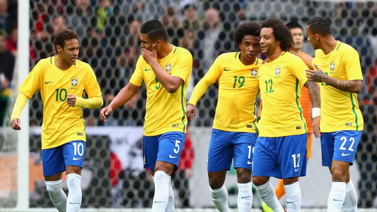Willian celebrates with his Brazil team-mates after Marcelo scored their second goal