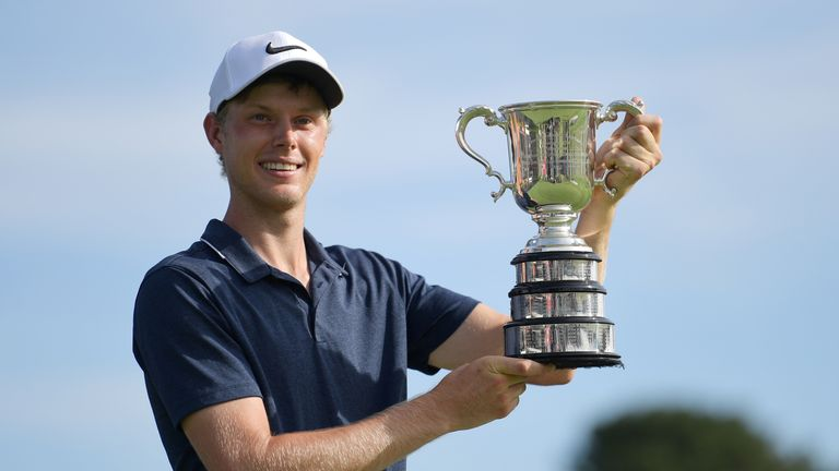 Cameron Davis proudly displays the trophy after his Australian Open triumph