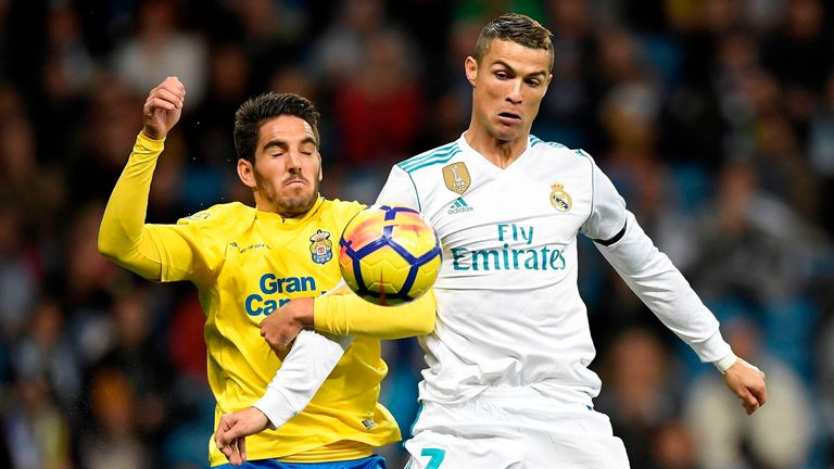 Cristiano Ronaldo (R) challenges for possession
