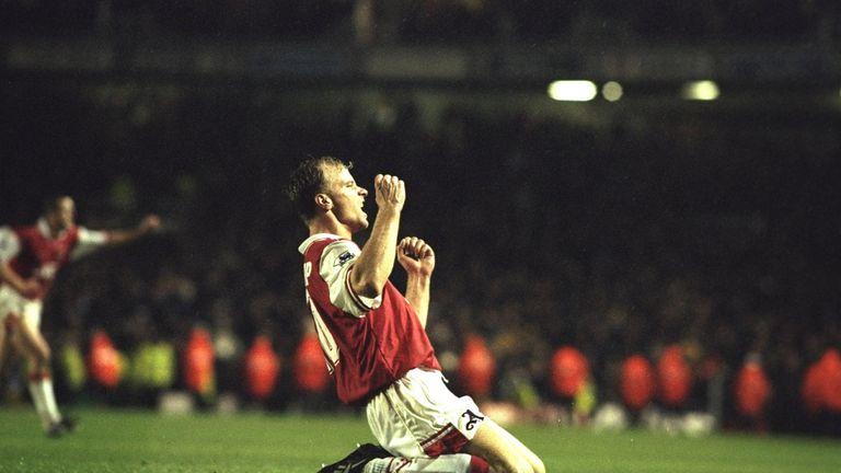 Dennis Bergkamp celebrates against Tottenham