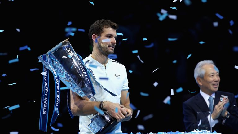 Grigor Dimitrov celebrates with the ATP Finals trophy