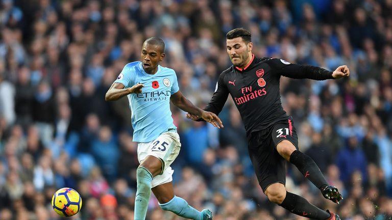 Fernandinho (left) battles with Sead Kolasinac of Arsenal during Man City's 3-1 win on Sunday