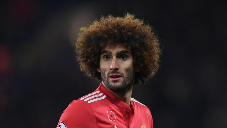 Marouane Fellaini looks on his way out of Old Trafford