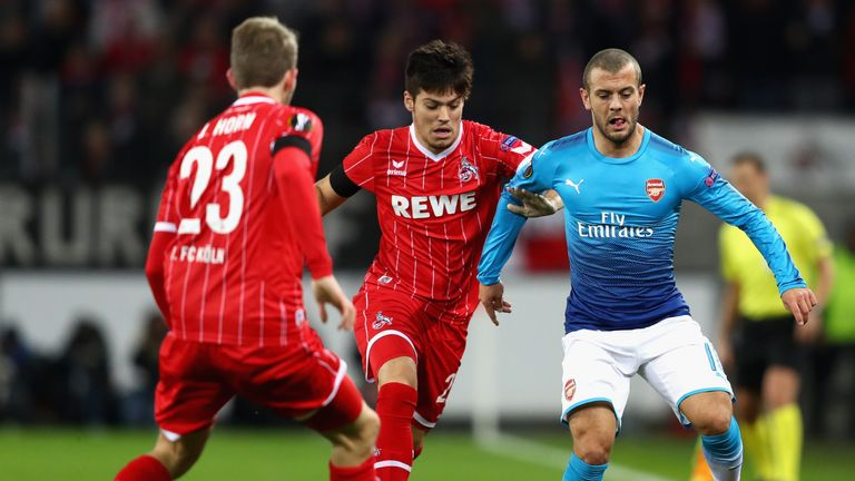 Cologne's Jorge Mere and Arsenal midfielder Jack Wilshere battle for possession