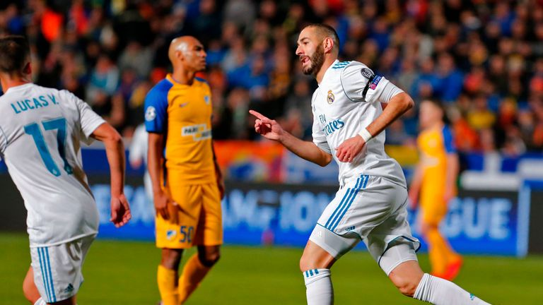 Karim Benzema celebrates the first of his two goals on the night