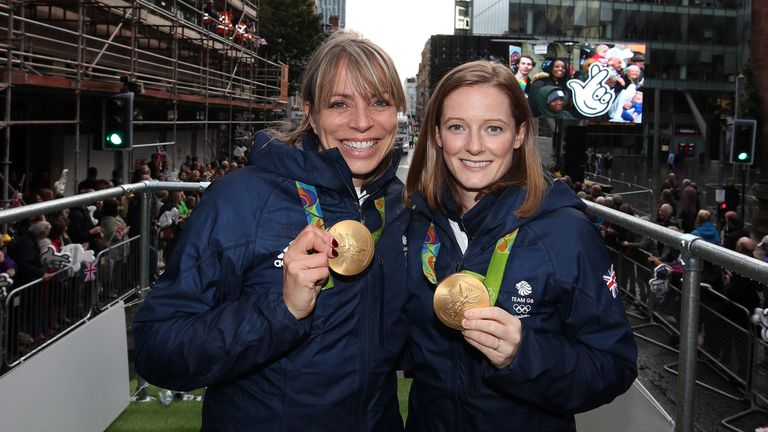 Kate and Helen proudly show their gold medals during the Olympic Parade in Manchester in October 2016