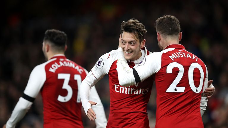 Mesut Ozil scored Arsenal's fourth goal against Huddersfield