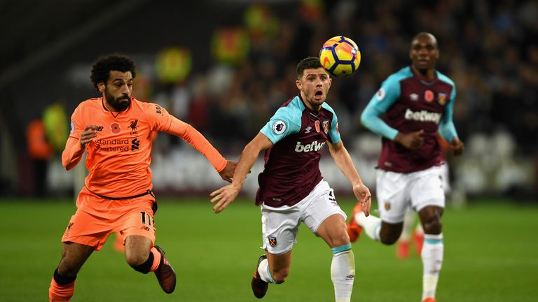 Liverpool's Mohamed Salah makes the starting XI down the right flank