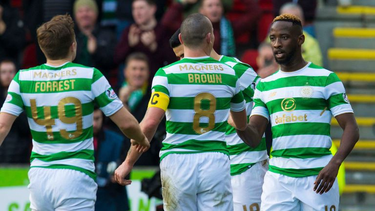 Moussa Dembele (right) celebrates after scoring against St Johnstone
