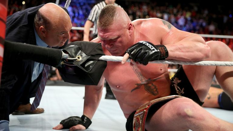 Lesnar takes post-match advice from his advocate, Heyman