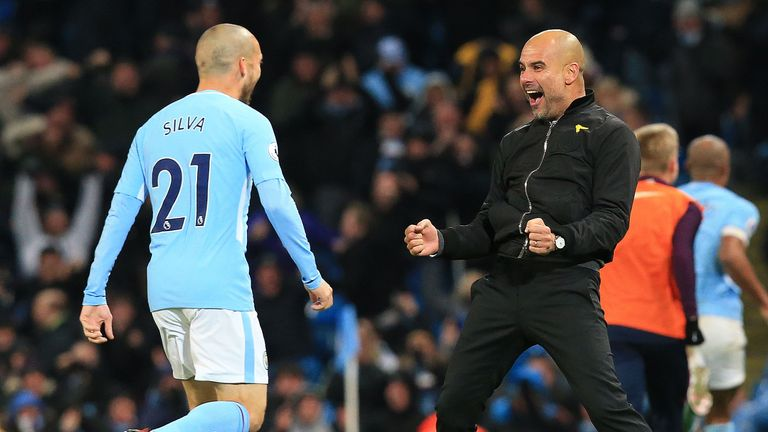 David Silva and Pep Guardiola celebrate Raheem Sterling's winner