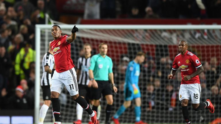 Anthony Martial celebrates his 37th-minute equaliser
