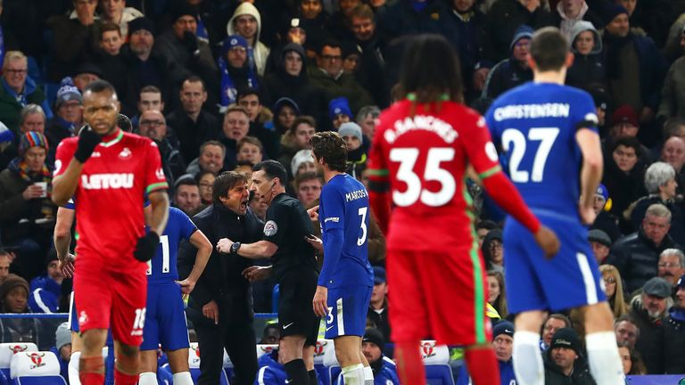 Antonio Conte remonstrates with referee Neil Swarbrick before being sent to the stands