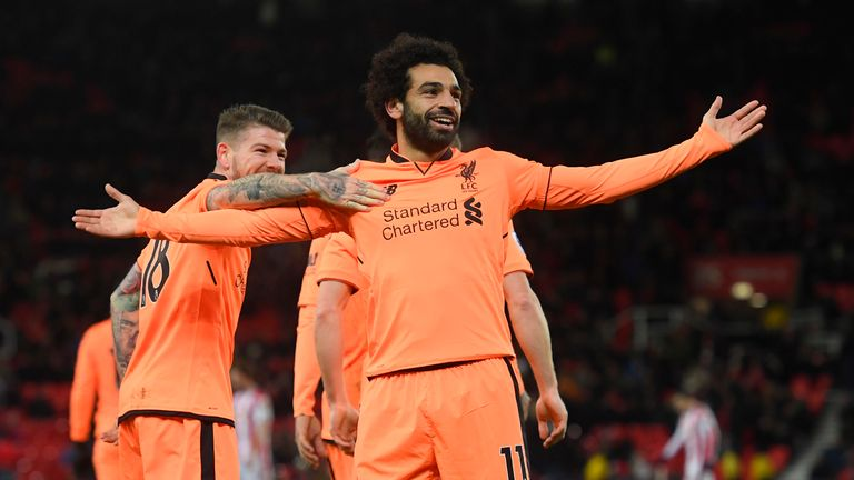 Mohamed Salah celebrates his second and Liverpool's third goal