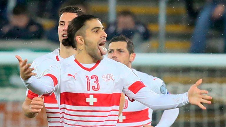 Switzerland's Ricardo Rodriguez celebrates scoring from the penalty spot