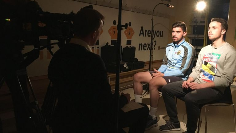 Ruben Neves and Diogo Jota (R) being interview by Sky Sports' Jonathan Oakes