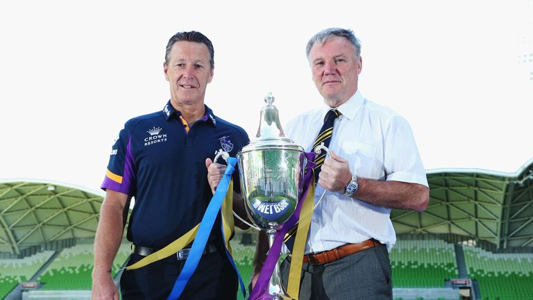 Melbourne head coach Craig Bellamy (left) and Gary Hetherington pose with the World Club Challenge trophy