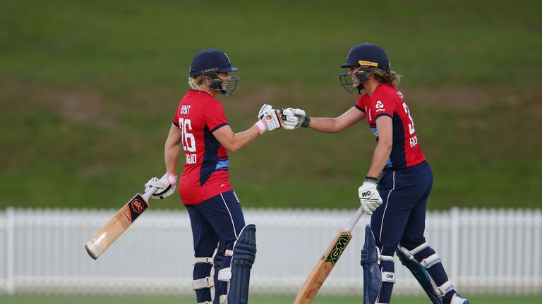 SYDNEY, AUSTRALIA - NOVEMBER 15:  Sarah Taylor (R) of England celebrates with Katherine Brunt after reaching her half century during the T20 match between