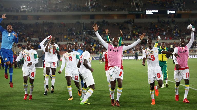 Senegal's players celebrate after qualifying for next summer's World Cup
