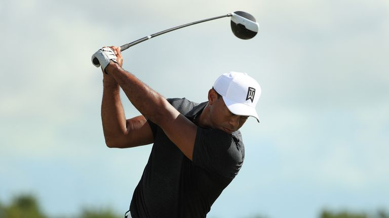 Tiger Woods warms up on the range prior to the first round of the Hero World Challenge