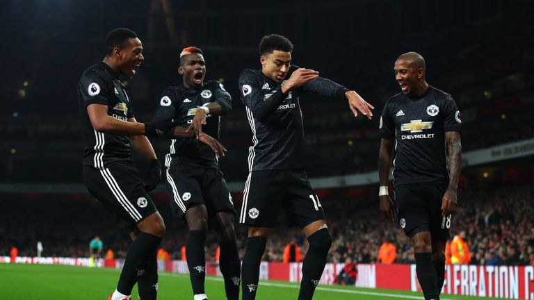 Jesse Lingard celebrates after scoring Manchester United's second at the Emirates