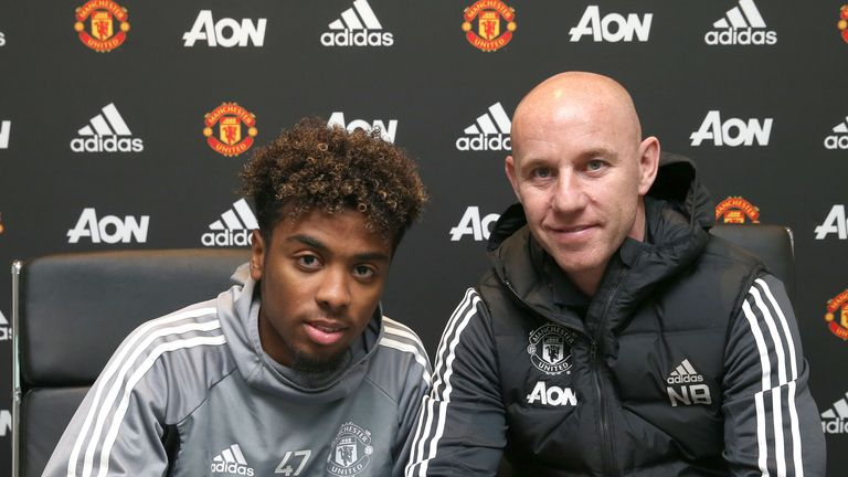 Angel Gomes (l), pictured with Nicky Butt, has signed his first professional contract