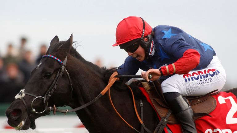 Black Corton and Bryony Frost in winning action at Kempton