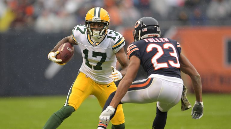 Fuller prepares to tackle Davante Adams of the Green Bay Packers