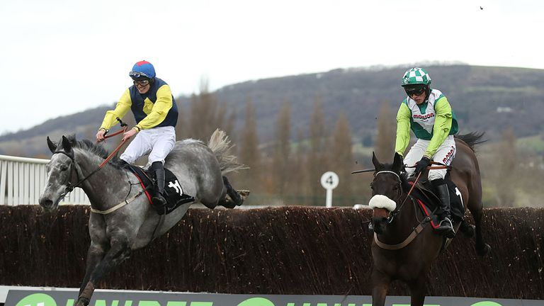 Guitar Pete (left) ridden by Ryan Day jumps the last to win the Caspian Caviar Gold Cup
