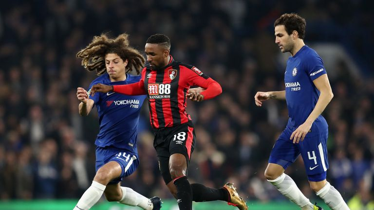 Ethan Ampadu battles for possession with Jermain Defoe