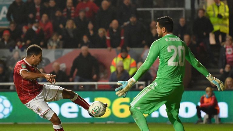 Korey Smith scores Bristol City's second goal past Sergio Romero of Manchester United during the Carabao Cup quarter-final