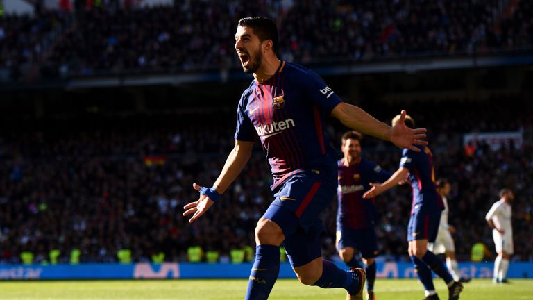 Luis Suarez scored Barcelona's first goal in their 3-0 win at Real Madrid