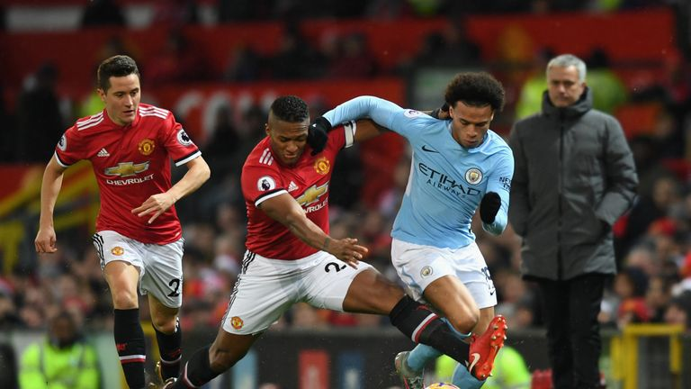 Leroy Sane and Antonio Valencia in action during the Manchester Derby at Old Trafford