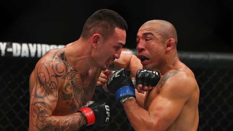 Max Holloway (L) has twice inflicted defeat on Jose Aldo