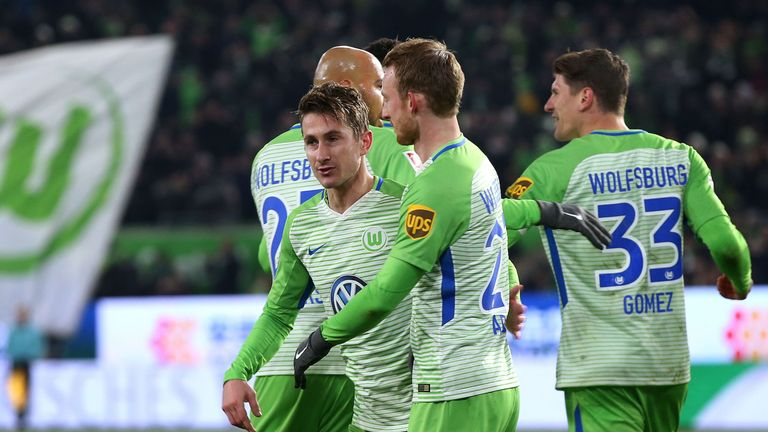 Wolfsburg's Dutch defender Paul Verhaegh celebrates after scoring a penalty with John Anthony Brooks (L), Maximilian Arnold and Mario Gomez.
