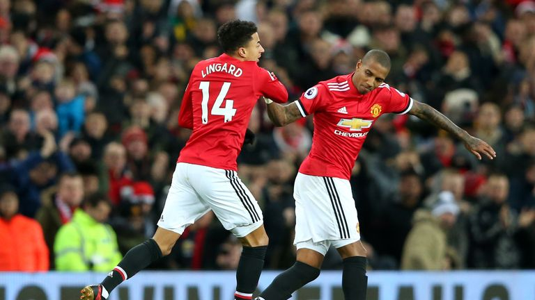 Sub Lingard celebrates with Ashley Young after pulling a goal back