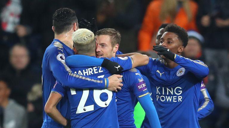 Jamie Vardy celebrates scoring the opening goal with team-mates