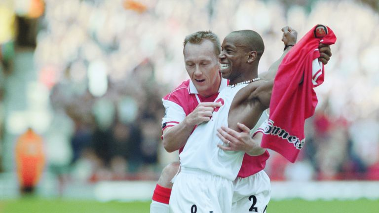 Ian Wright celebrates with Lee Dixon after breaking Cliff Bastin's Arsenal goalscoring record of 178 goals with a hat-trick against Bolton