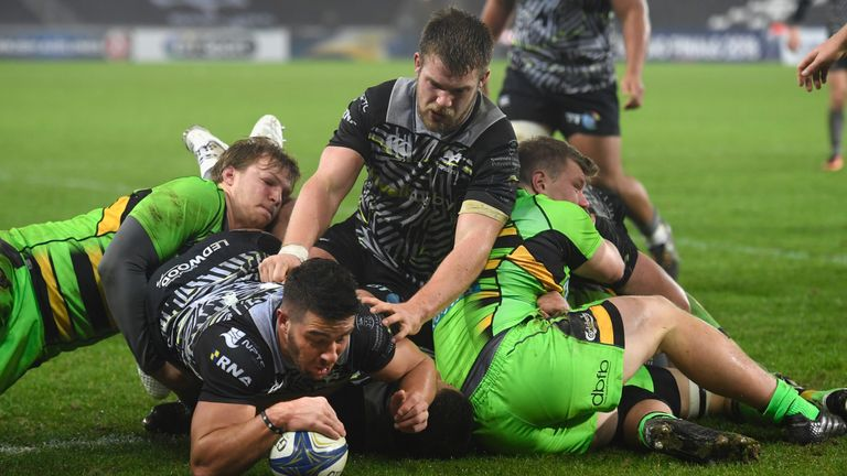 Rhys Webb dives over to score his second Ospreys' try against Northampton