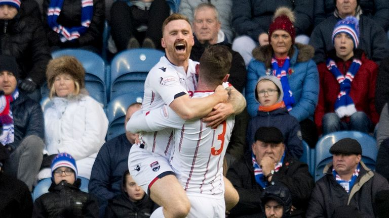 County's Craig Curran (left) celebrates his early goal at Ibrox with Jason Naismith