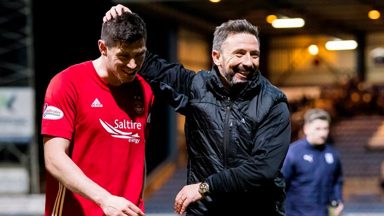 Derek McInnes celebrates with Scott McKenna at full-time at Dens Park