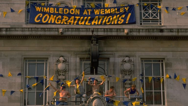 Wimbledon fans celebrate their victory after the FA Cup final against Liverpool