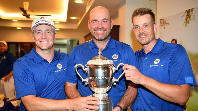 Europe captain Thomas Bjorn celebrates with Alex Noren and Henrik Stenson