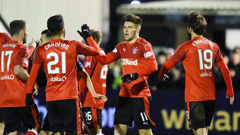 Rangers' Josh Windass (second right) celebrates his second goal