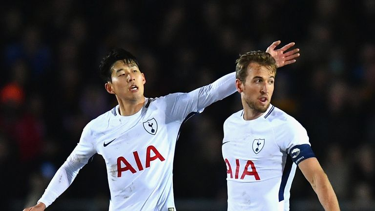 Harry Kane of Tottenham Hotspur celebrates with Heung-Min Son after scoring against Newport