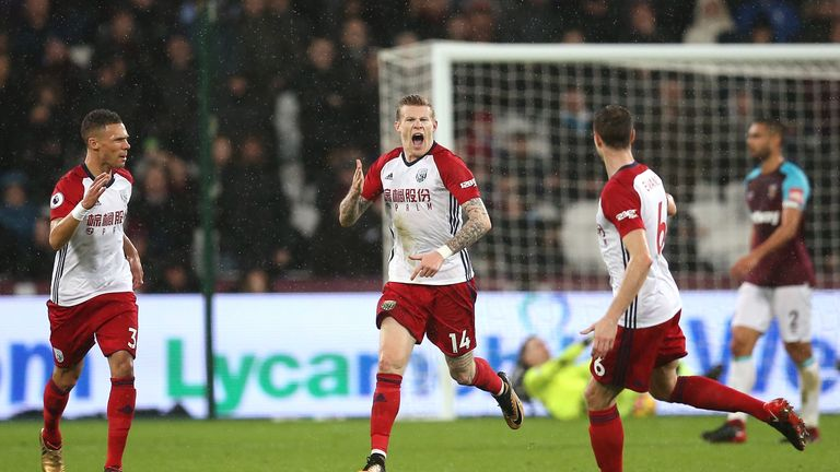 James McClean celebrates after scoring the opening goal at the London Stadium