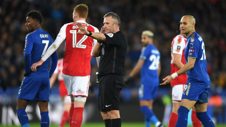Referee Jon Moss calls for video assistance prior to awarding Leicester's second goal
