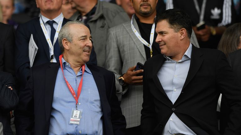 Swansea owners Steve Kaplan (l) and Jason Levien (r) have postponed plans to increase their stake in the club